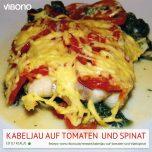 Kabeljau auf Tomaten und Blattspinat